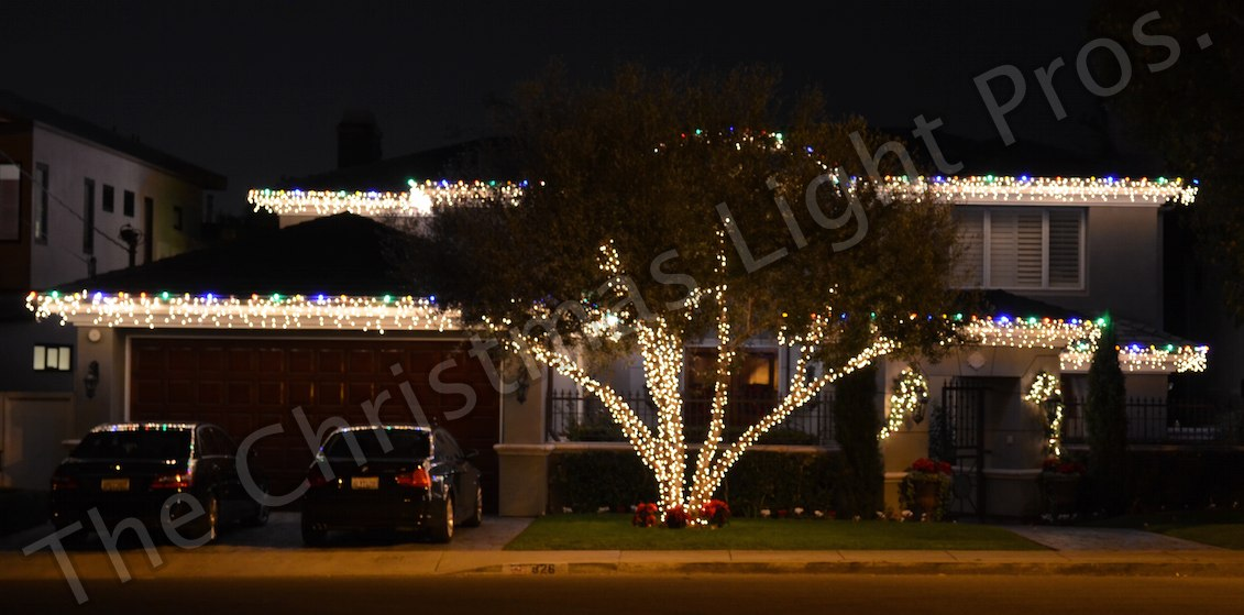 Featured - White Wire White Icicle Lights combined with a Multi color LED boarder With 4_ tree wrap in Olive