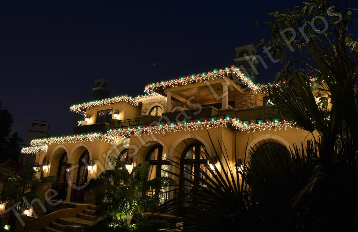 Featured - White Wire White Icicle Lights combined with a Red & Green LED alternating bulb every 12_ as boarder